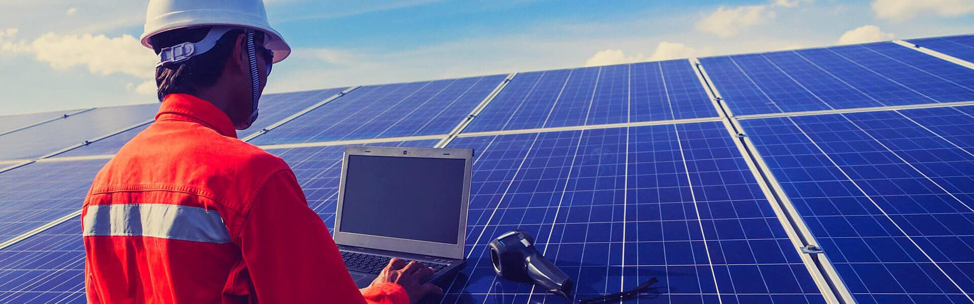 a person using laptop on the solar panel