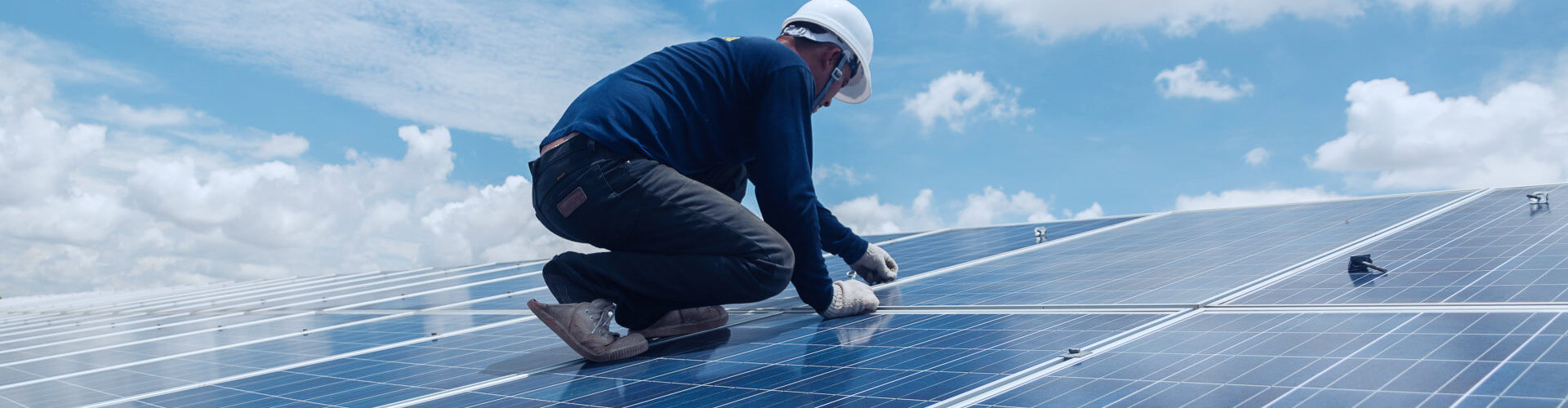 a person working with solar panels