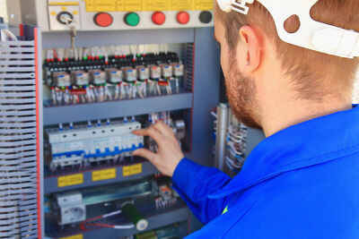 electrical engineer performs switching of industrial equipment