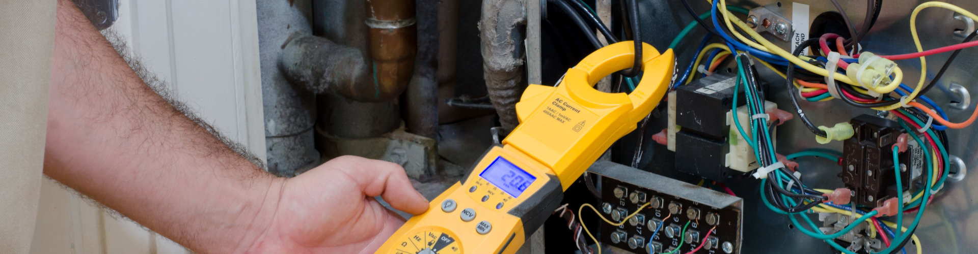 technician checking the amperage
